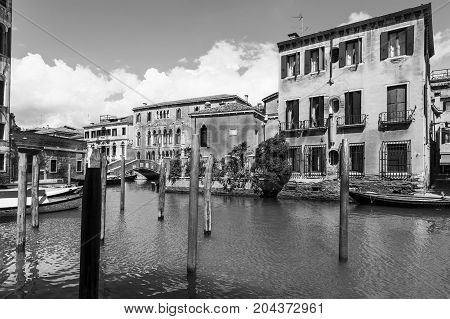 Houses peeling off from dampness. Venice is situated across a group of islands that are separated by canals and linked by bridges. Black and white picture