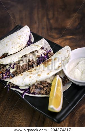 gourmet beef kebab pita sandwiches with garlic yoghurt sauce