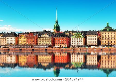 Scenic summer panorama of the Old Town (Gamla Stan) architecture pier in Stockholm Sweden