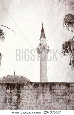 Sinan Pasha Mosque with dome in the old town of Acre Israel. Muslim mosque and minaret in the old city of Akko. Vintage style toned picture