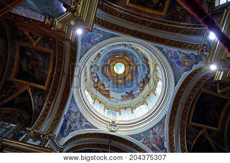 MDINA, MALTA - MARCH 29, 2017 - Dome showing a crucifixion scene inside St Pauls Cathedral also known as Mdina Cathedral Mdina Malta Europe, March 29, 2017.