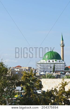 Restoration of Muslim mosque in the old city of Akko. Al-Jazzar mosque as fine example of the Ottoman architecture in old Acre Israel.