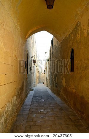 View along an alleyway in the old town Mdina Malta Europe.