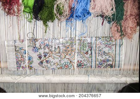 Scenes hunting for handmade carpets of silk. Samarkand silk carpet factory