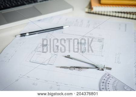 blueprint paper drafting project sketch architectural dividers ruler engineering tools on workplace.