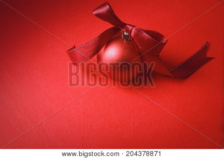 Red christmas ball with tape isolated on background.