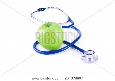 Medical stethoscope and apple isolated on white background.