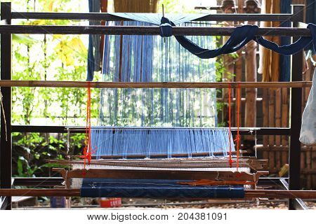 Thai traditional equipment for weaving knitting, local tool picture, upcountry lifestyle at village east of Thailand, home made textile business