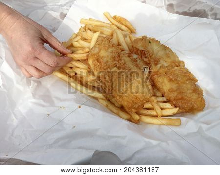Woman Eats Fish And Chips Fast Food