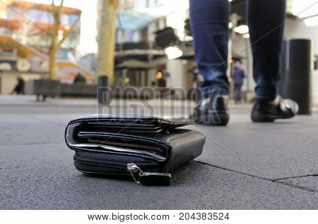 Woman Losing Her Wallet On City Street