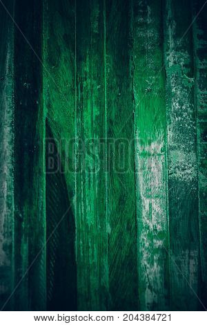 Old green vintage wood. Dark green vintage wood texture and background. Abstract texture and background for designers. Old vintage wood paint in dark green. Rough green wood background and texture