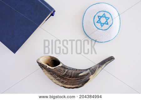 Flat Lay View Of Shofar, Torah Book And Kippa Background