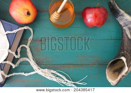 Flat Lay View Of Torah Book Tallit Pomganet Honey And Apple Background