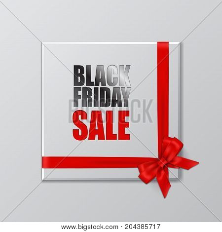 Vector Black Friday Sale promotion template. Silver gift box with Black Friday Sale text, red ribbon and bow.