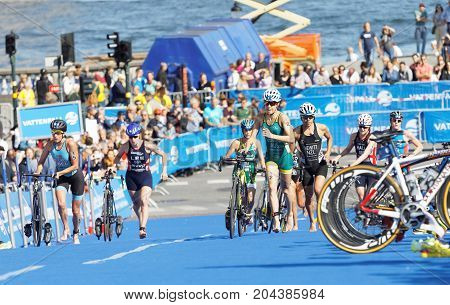 STOCKHOLM - AUG 26 2017: Female triathlete Gentle (AUS) and Hewitt (NZL) and competitors running in the transition zone in the Women's ITU World Triathlon series event August 26 2017 in Stockholm Sweden