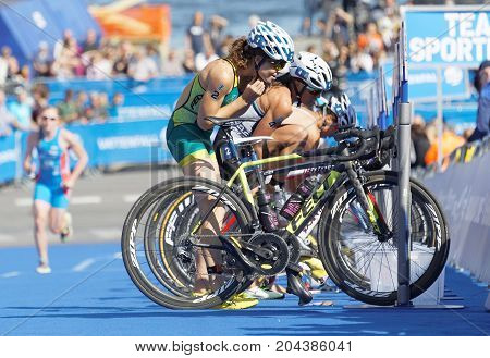 STOCKHOLM - AUG 26 2017: Female triathlete Ashleigh Gentle (AUS) and Andrea Hewitt (NZL) taking of helmets in the transition zone in the Women's ITU World Triathlon series event August 26 2017 in Stockholm Sweden