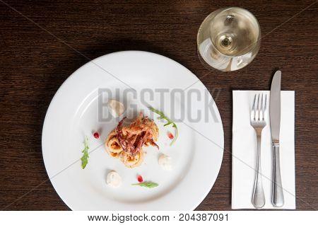 Calamari Freshly Prepared Seafood On A White Plate