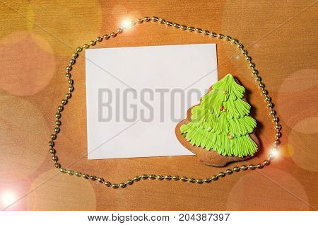 Greeting card with gingerbread cookie. Top view.