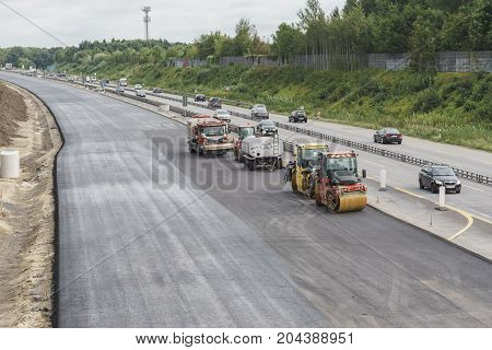 QUICKBORN, GERMANY - SEPTEMBER 11: Highway road a7 construction works with roller compactor machine.