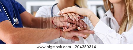Group Of Doctor Crossed Arms In Pile For Win Closeup