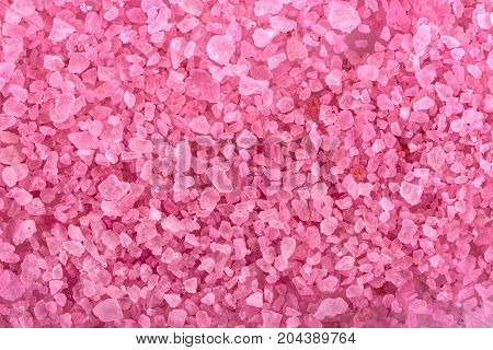 the pink aromatic bath salt background .
