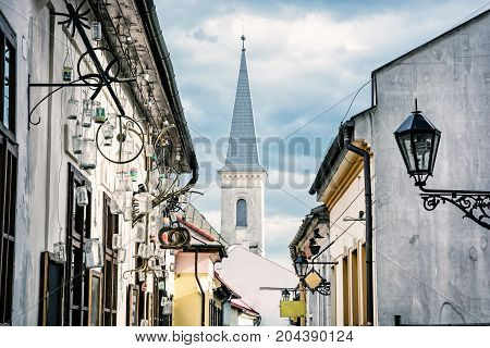 Hrnciarska street with Calvinist church in Kosice Slovak republic. Folk art theme. Beauty photo filter. Religious architecture.