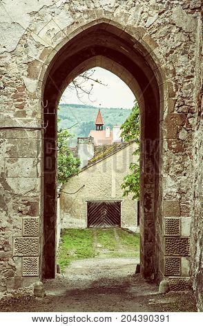 Entrance to the Veveri castle area Czech republic. Ancient architecture. Yellow photo filter. Travel destination.