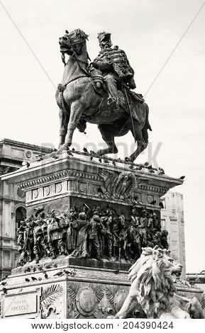 Equestrian statue of Vittorio Emanuele II in Milan city Italy. Cultural heritage. Photo filter. Black and white.