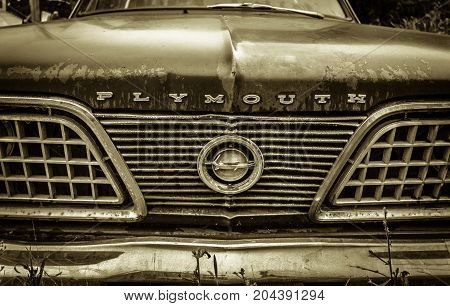 Croswell, Michigan, USA - August 24, 2017: Grill, front bumper and logo of a 1966 Plymouth Barracuda.