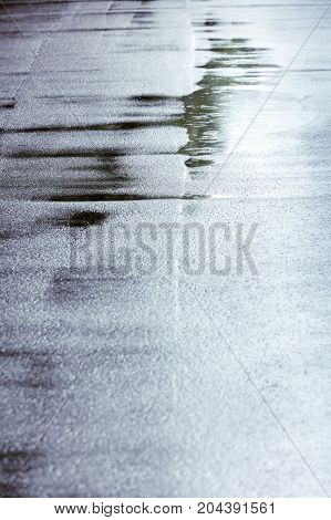 Background With Raindrops And Water Circles On Dark Asphalt