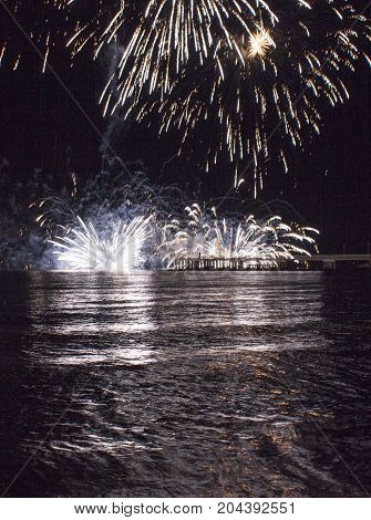 MARINA DI MASSA, ITALY - AUGUST 22 2015: Firework by the sea in Marina di Massa Italy from its famous pier