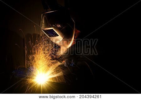 Industrial Worker at the factory welding closeup welder Industrial automotive part in factory selective focus