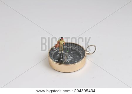 Fun Of Figure Man Standing On Compass