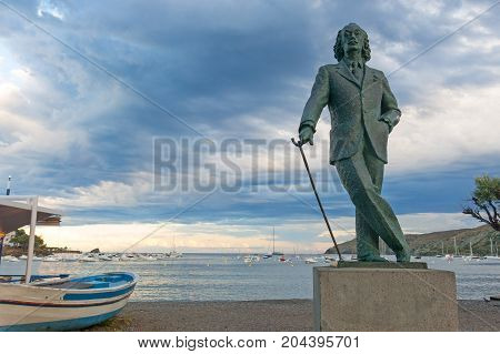 Detail Of A Bronze Life-size Statue To Famous Salvador Dali In Cadaques, Spain