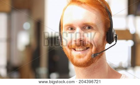 Male Telephone Customer Service Operator, Happy In Office At Work