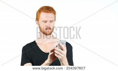 Young Red Hair Man Holding Mobile Smartphone Using App Texting Sms Message