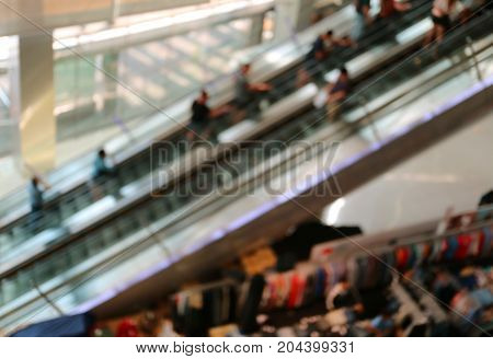 Abstract blurred many people on the escalators in a shopping mall, Background