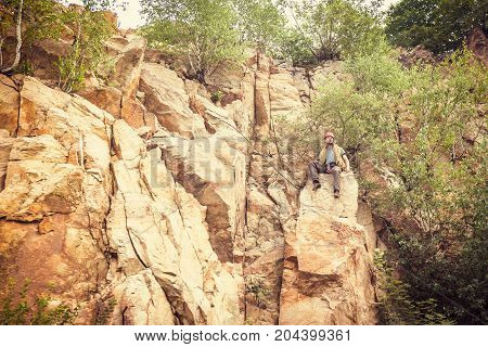 Young climber getting ready for rock climbing