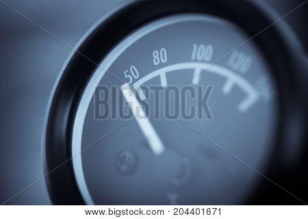 Close up shot of a car's oil temperature gauge.