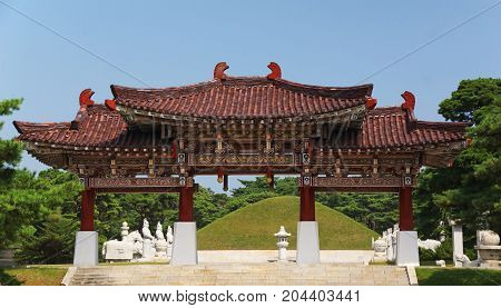 a traditional wood building is the entrance to the tomb of koguryo near to Pyongyang in North Korea