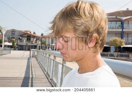 Pensive Teenager Portrait On The City Street