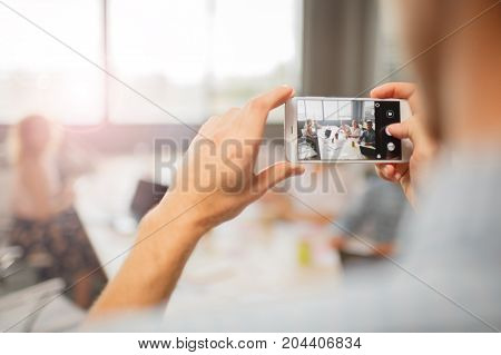 Close-up picture of boy, making photo in the office.