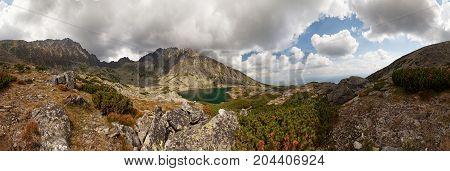 Panorama of valley with beautiful alpine lake ander highest peak of Tatra Mountains - Gerlachovsky stit