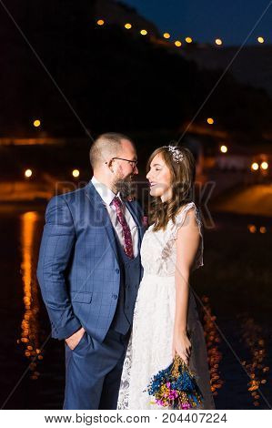 Wedding Couple By The Lake At Night