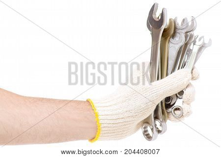 Male hand holding a construction key on a white background isolation