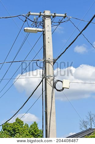 Electricity pylon with street light in summer