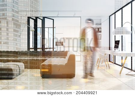 White living room interior with a panoramic window a long black sofa a bookcase and a computer table. A kitchen is seen in the background. A man. 3d rendering mock up toned image double exposure