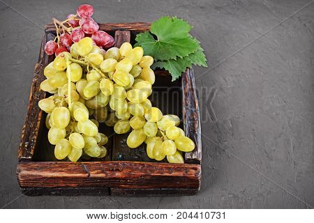Healthy Food. Close-up View Bunch Of Green And Pink Grape In Vintage Wooden Box