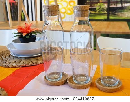 Kitchen Utensil Set of Porcelain Dishes with Empty Glasses and Glass Bottles Used to Set A table for Eating A Meal.