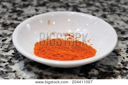 Bowl of Red Hot Paprika Powder or Chili Powder A Ground Spice Made From Chili Bell Pepper or Sweet Pepper.